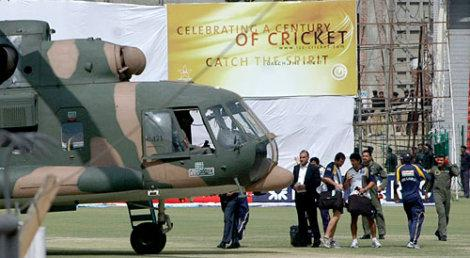Srilankan players prepare to leave the Gaddafi stadium on a military helicopter
