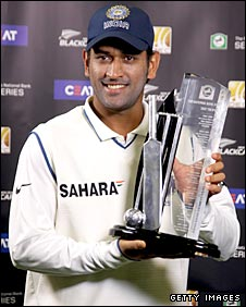 Dhoni with the trophy after India completed a 1-0 win in the test series against the Kiwis