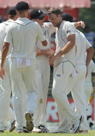 Daniel Vettori being congratulated by his team mates on reaching 300 test wickets